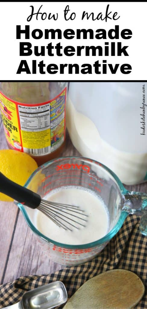 A look at homemade buttermilk inside a measuring cup with a whisk with a lemon, vinegar, and a milk jug in the background.