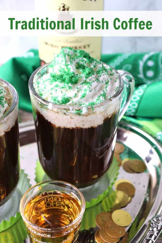 Closeup photo of Irish coffee with a shot of whiskey, whipped cream, and green sugar