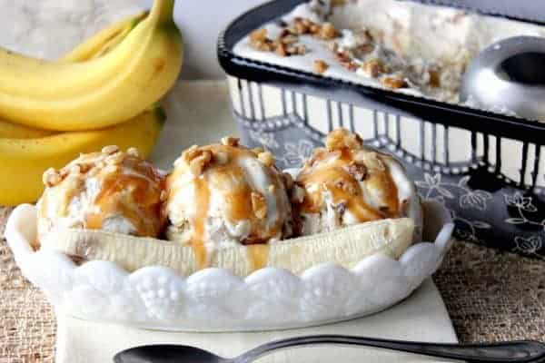 Banana split dish with banana walnut ice cream and caramel sauce.