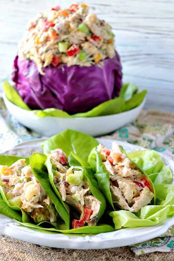 Chicken salad in lettuce cups and in a purple cabbage bowl.