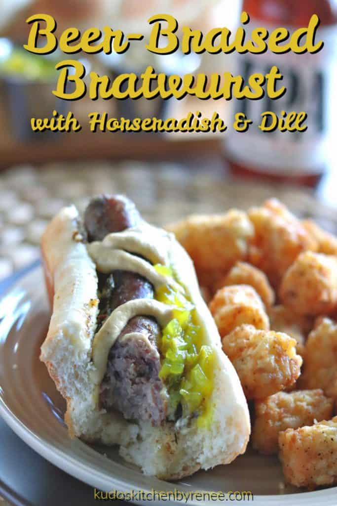 Vertical title text image of a beer braised bratwurst in a bun with mustard, relish, and a bite taken out.