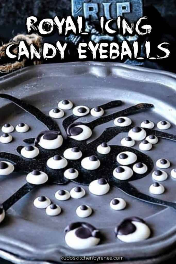Vertical title text image of royal icing candy eyeballs on a spooky gray plate with a spider silhouette.